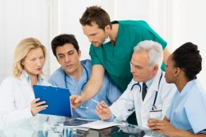 team of experts doctors examining medical exams